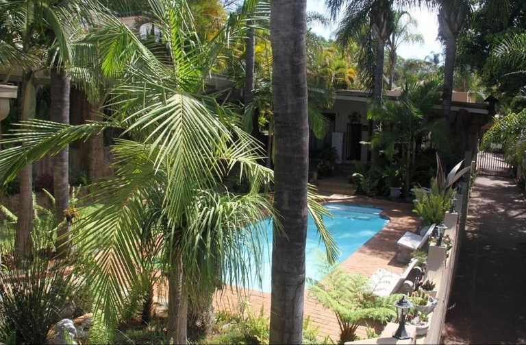 View of the pool/garden/braai area from the balcony